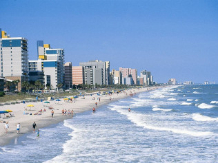 Myrtle Beach, South Carolina shoreline with people and hotels